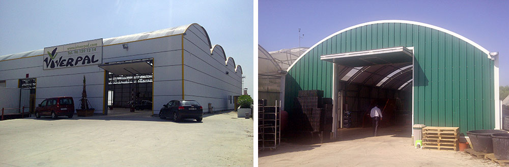 Curved roof warehouse with large lift-gates installed
