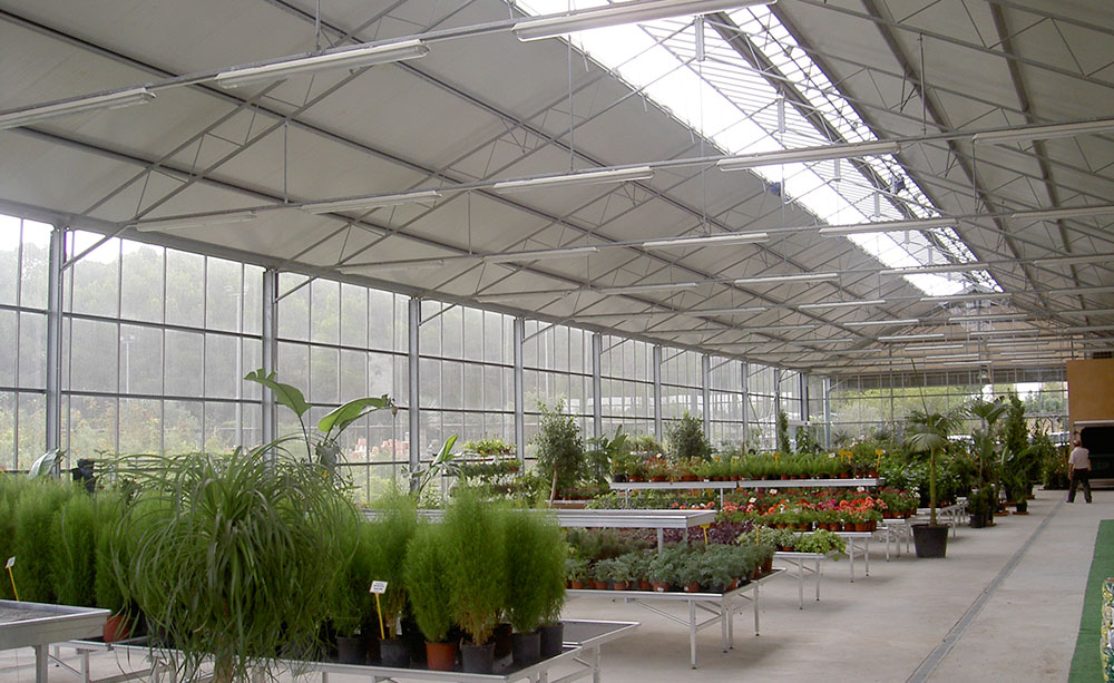 Interior view of garden center with PW wide-span greenhouse model